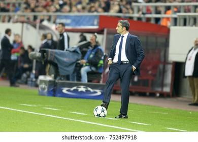Piraeus, Greece October, 31,2017.  Barcelona's coach Ernesto Valverde with the ball in the champions league football match Olympiacos vs Barcelona in Piraeus.