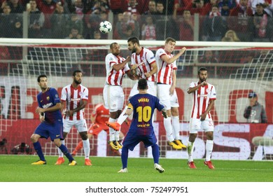 Piraeus, Greece October, 31,2017. Barcelona's Leo Messi he shoots a foul against Olympiacos's players in the  match Olympiacos vs Barcelona in Piraeus.