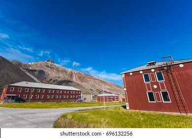 Piramiden, Spitsbergen, Svalbard - july 25 , 2017 Landscape of the Russian city in the summer in the Arctic In sunny weather and blue sky