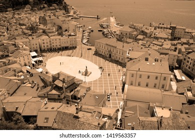 PIRAN SLOVENIA 05 17 2019: Bird eyes view of Piran and Tartini Square on the Gulf of Piran on the Adriatic Sea from the Cathedral of St George's free-standing, 46.5m bell tower