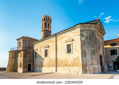 Piran, Slovenia: Beautiful ancient church near the sea, placed on Piran coast. Old town church from the stone in summer weather with blue sky. Famous tourist destination in Europe