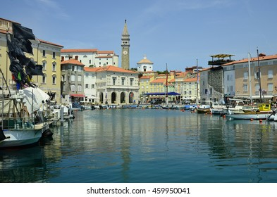 PIRAN, SLOVENIA - JULY 04: Tiny harbor with boats, cityscape and bell tower in the pictoresque village on Adriatic sea