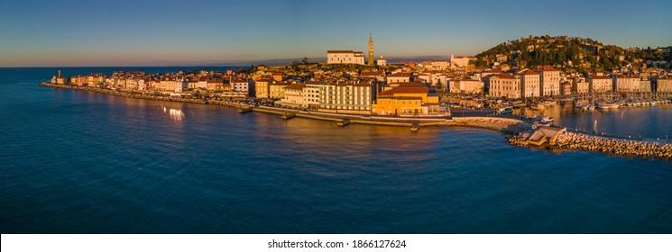 PIRAN, SLOVENIA - NOVEMBER 30, 2020: Panoramic aerial view of beautiful town Piran in golden hour