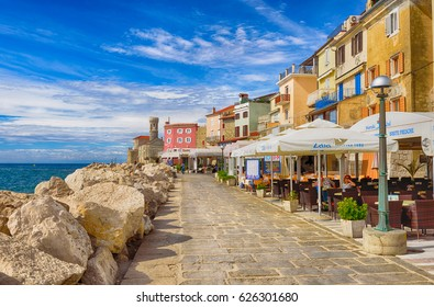 Piran, Slovenia - September 19, 2016: the Scenic waterfront, with bright colorful buildings in the historic centre of Piran. Piran is one of Slovenia's major tourist attractions