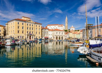 Piran, Slovenia - September 19, 2016: a view of the city of Piran with beautiful old buildings and boats in the Harbor. Piran is one of Slovenia's major tourist attractions.
