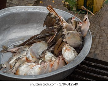 Piranhas and other fish from the Amazon River in a large metal bowl at the bazaar in the port of Tabatinga, Brazil