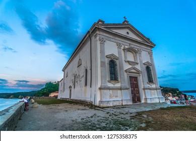 PIRAN/SLOVENIA - June 12, 2018: The St. George's Parish Church in the Venetian Renaissance architectural style as seen on 12. 6. 2018 in Piran, Slovenia.