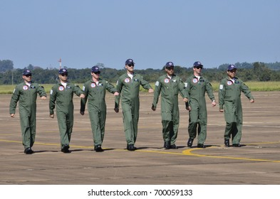 PIRASSUNUNGA, BRAZIL - May 13, 2017 - 65th Smoke Squadron celebration, pilots walking to their aircraft's