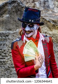 Pirate crook is holding bundle of dollars