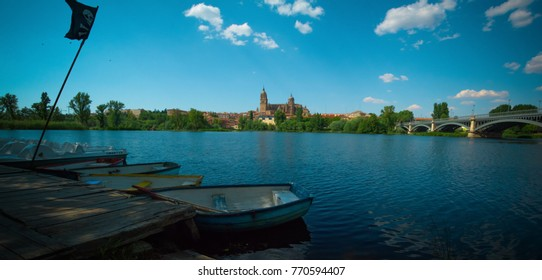 Pirate flag, boat, lake. Beautiful view to Catedral Nueva de Salamanca (New Cathedral of Salamanca), Spain.