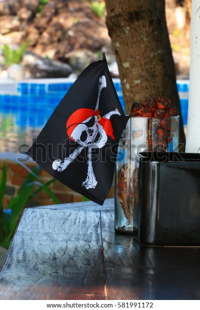 pirate flag  in the wooden table