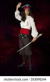 Pirate man with saber on a colorful background with glowing lights
