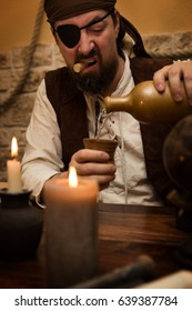a pirate pour out white rum, concept medieval and themeparty