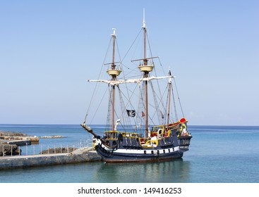 The pirate ship docked near Grand Cayman island, the popular tourist attraction in Caribbean (Cayman Islands).