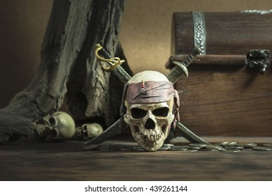 pirate skull with two swords and coffer over two head of human background still life style