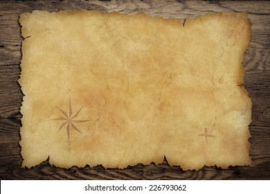 Pirates' old parchment treasure map on wood background