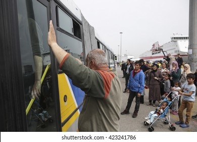 Pireaus port, Greece - March 30, 2016. 4000 and more refugees are stuck in E4 gate in Pireaus port under terrible conditions. A bus moves them to other camps.