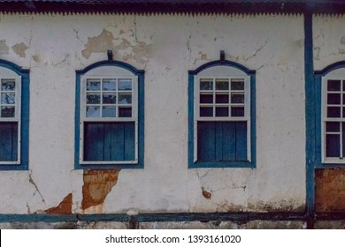 PIRENOPOLIS, BRAZIL - 28 APRIL, 2019: Large colonial house, white walls with blue windows and blue wooden beams, goias