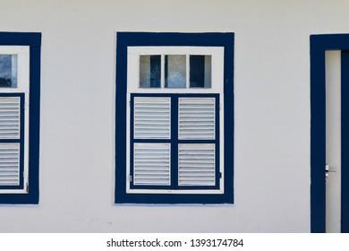 PIRENOPOLIS, BRAZIL - 28 APRIL, 2019: Colonial blue door with dark blue frame, made of wood, church of the Pirenopolis matrix