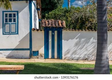 PIRENOPOLIS, BRAZIL - 28 APRIL, 2019: Popular house and blue & white door in the historical center of Pirenopolis Goias, sunny day