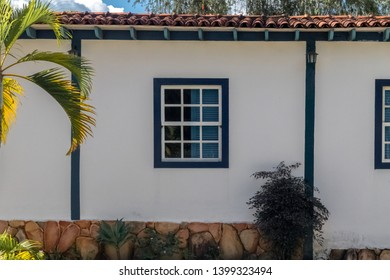PIRENOPOLIS, BRAZIL - 28 APRIL, 2019: Colonial withe window with blue frame, made of wood, church of the Pirenopolis matrix