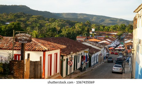 Pirenopolis / Brazil - May 2015: Streets of Pirenopolis with cars and houses.