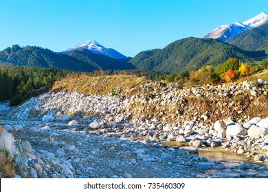 Pirin snow peaks mountains panorama, river and colorful autumn trees, Bansko, Bulgaria
