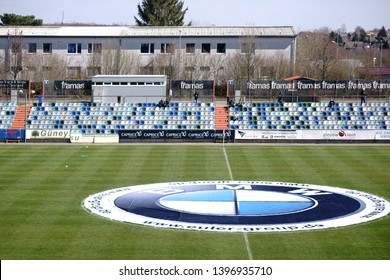 PIRMASENS, GERMANY - MARCH 30: The modern and colorful seats of a tribune of the sports park Husterhoehe of the soccer club FK Pirmasens on March 30, 2019 in Pirmasens.