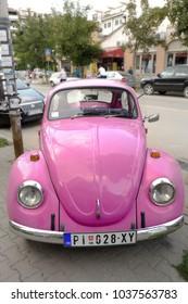 PIROT, SERBIA - JULY 27, 2017: Pink Volkswagen Beetle in Pirot Town, Serbia