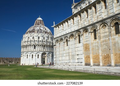 PISA - AUG 29: The Baptistery, dedicated to St. John the Baptist, stands opposite the west end of the Duomo. It was built by an architect known as Diotisalvi . August 29, 2014 in Pisa.