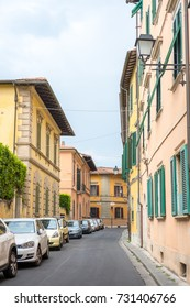 Pisa, Italy - 19 May 2017 : View of cars and building along the street in the old town of Pisa.