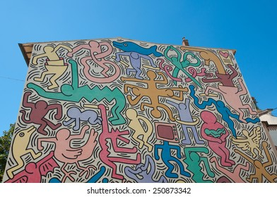 PISA, ITALY - 2 AUGUST 2013: The Pisa's Mural (1989) by Keith Haring. Theme of peace and harmony in the world - on the south wall of the Church of St Anthony