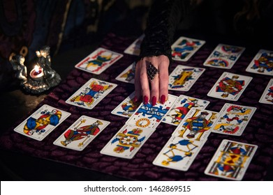 Pisa, Italy - 2015, January 1: Occult priest during a private session. Tarot readings is an ancient form of divination and prediction of the future.