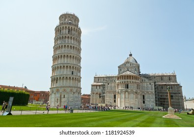 PISA, ITALY - August 30, 2018: Tourists on Square of Miracles visiting Leaning Tower in Pisa, Italy. Leaning Tower of Pisa is campanile and is one of the most famous buildings in the world