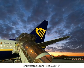 PISA, ITALY, DICEMBRE 12, 2018: Ryanair plane ready to harness at sunset. Ryanair is the major airplane low cost company in Europe.