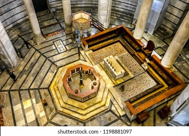 PISA, ITALY - JANUARY 09, 2018: Interior of Pisa Baptistery of St. John (Battistero di San Giovanni, 1363). Pisa Baptistery is an example of transition from the Romanesque style to the Gothic style.