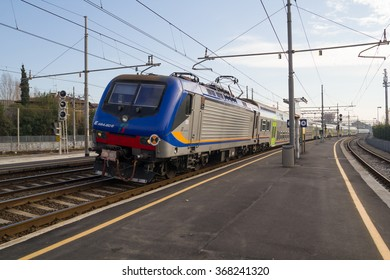 PISA, ITALY - JANUARY 24, 2016: Trenitalia Regional Passenger Train with Electrical Locomotive Model E464 is Arriving in the Station.