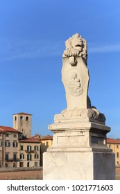Pisa, Italy - January 28, 2018: Lion statue on the entrance of Ponte Solferino, a bridge on the Arno river in Pisa.