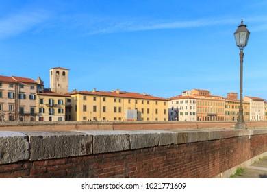 Pisa, Italy - January 28, 2018: Riverside near the Arno river in Pisa.