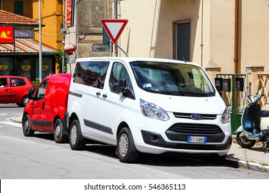 PISA, ITALY - JULY 31, 2014: White van Ford Transit in the city street.