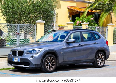 PISA, ITALY - JULY 31, 2014: Motor car BMW E84 X1 in the city street.