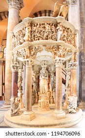 PISA, ITALY - JULY 7, 2018: Italian gothic Pulpit by Giovanni Pisano in Pisa Cathedral at Piazza dei Miracoli (Piazza del Duomo).