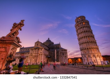 Pisa, Italy - July 8, 2018: Piazza dei miracoli, with the Basilica and the Leaning Tower, Pisa, Italy.