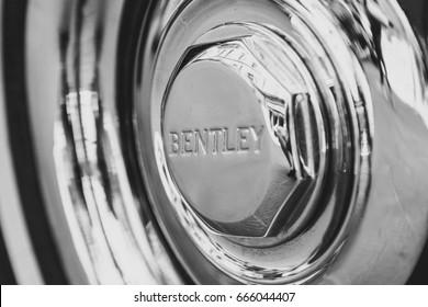 PISA, ITALY - JUNE 18, 2017: Bently inscription closeup on vintage car wheel.