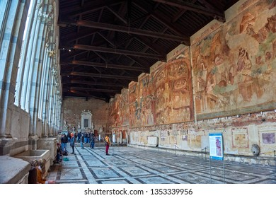 Pisa, Italy - March 2019: Panoramic view of interior of Campo Santo, also known as Camposanto Monumentale (monumental cemetery), is a historical edifice at northern edge of Cathedral Square in Pisa