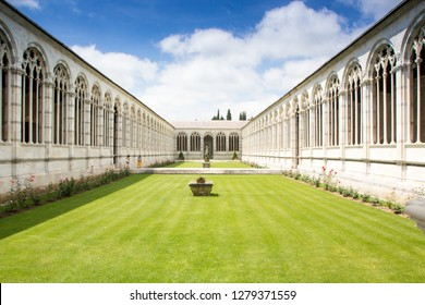 Pisa, Italy - May 24, 2018:  Campo Santo (Camposanto Monumentale) or Camposanto Vecchio - monumental old cemetery on the Field of Miracles (Campo dei Miracoli) in Pisa.