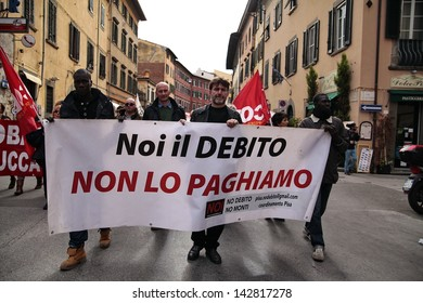 PISA, ITALY - NOVEMBER 14:Protesters march during a demonstration against austerity organized in all Europe as a European general strike on November 14, 2012 in Pisa, Italy