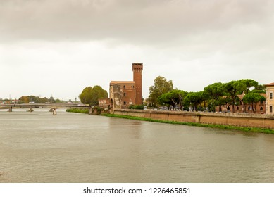"PISA, ITALY - OCTOBER 29, 2018: View of the medieval town of Pisa from bridge ""Ponte di Mezzo"" on river Arno"