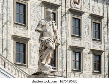 PISA, ITALY - SEPTEMBER 20, 2014: Statue of Cosimo I de Medici in front of Palazzo della Carovana, the main building of the famous university Scuola Normale Superiore at Piazza dei Cavalieri in Pisa.