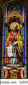 PISA, ITALY - SEPTEMBER 26. 2017 Saint Bernard Stained Glass Baptistery of Saint John Piazza del Miracoli Cathedral Pisa Tuscany Italy. Completed in 1363. Saint Bernard helped end schism church.